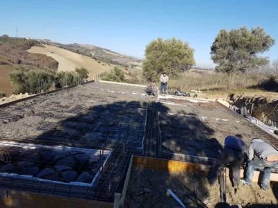 Covering The Steel at new house construction in Le Marche