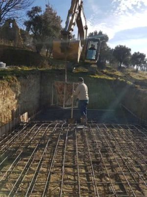 Starting To Pour Pool at new house construction in Le Marche