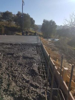 Starting To Smooth the Concrete  at new house construction in Le Marche