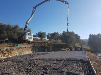 Continuing The Smoothing of the Concrete at new house construction in Le Marche