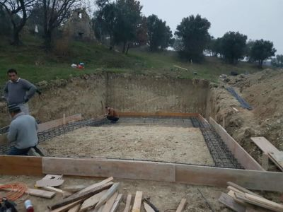 Pool concrete forms being placed at building site in :Le Marche