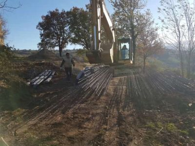 Steel being moved for pilings at building site in :Le Marche