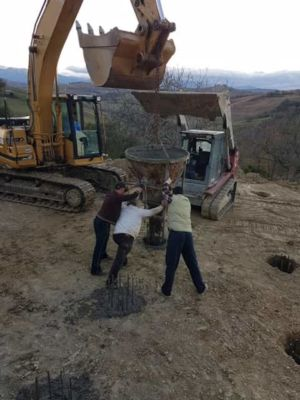 Starting to pour concrete at building site in :Le Marche