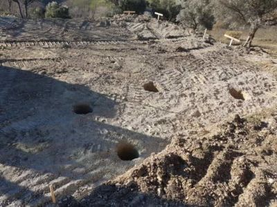 All concrete piling holes dug at building site in :Le Marche