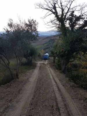Concrete truck arriving at building site in :Le Marche