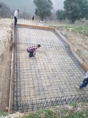 Working on steel in pool bottom at building site in :Le Marche