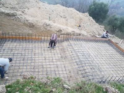 Placing steel in deep end of pool at building site in :Le Marche