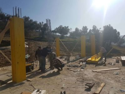 Anchoring the Steel at new house construction site in Le Marche