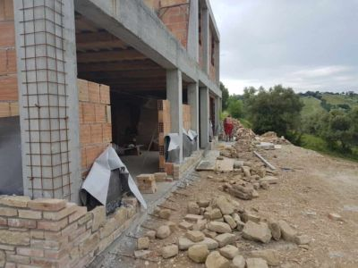 Across the Back of a new stone house in Le Marche