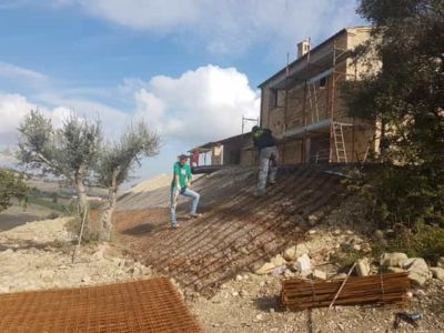 Across the First Slope Below the House at the site of new construction in Marche