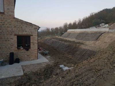 Across the Slope in Front of a new house being built in Le Marche, Italy