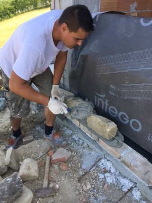 Adding More Stone on a new stone house in Le Marche