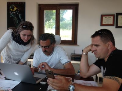 Alessandra, Kevin, and Francisc in a design planning meeting for a new house in Le Marche