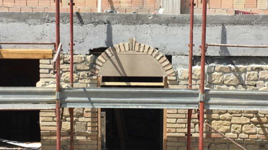 Arch over Portone at a new stone house being built in Le Marche