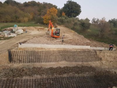 Backfill Work Behind Wall in front of a new house being built in Le Marche, Italy