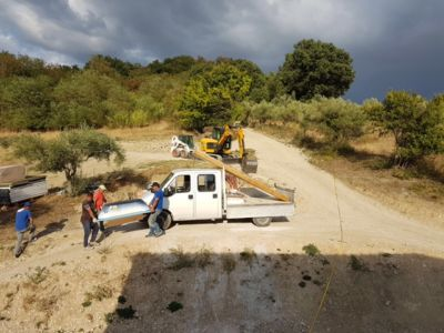 Bathtub Being Unloaded at a new house being built in Le Marche