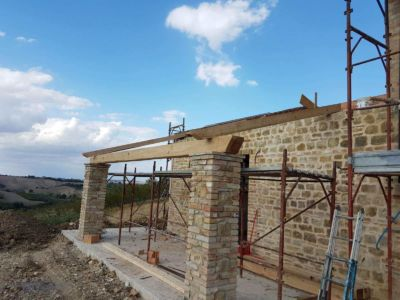 Beam Across Portico Columns at a new building site in Le Marche, Italy