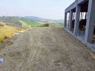 Behind the House Ready for Sidewalk Work at a new house being built in Le Marche Italy