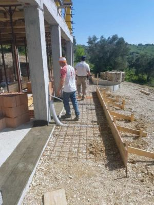 Concrete Form with Steel Mesh surrounding a new house being built in Le Marche