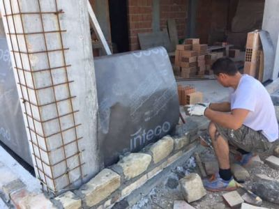 Continuing Down the Wall on a new stone house in Le Marche
