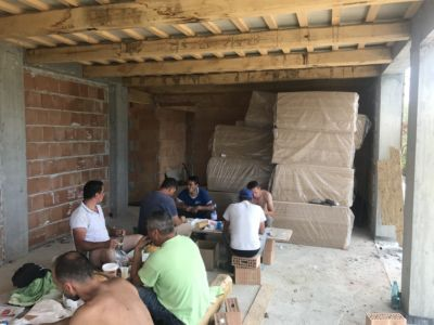 Crew at Lunch  at site of a new house being built in Le Marche, Italy