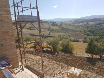 Digging Behind House Underway at a new building site in Le Marche, Italy