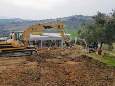 Digging, House, and View as part of house construction project in Le Marche