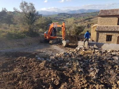 Digging to Extend Retaining Wall in front of a new house being built in Le Marche, Italy