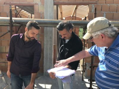 Discussing Roof Slope with Jimmy and Kevin at a new building site in Le Marche