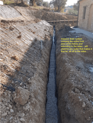 Drainage Ditch in front of a new house being built in Le Marche, Italy