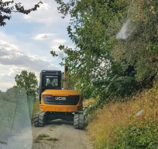 Equipment Arriving to reshape land behind a new house being built in Le Marche, Italy