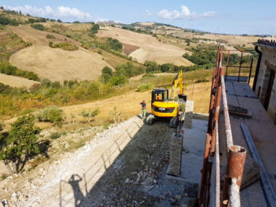 Extending the Terrace Beyond the Portico behind a new house being built in Le Marche, Italy