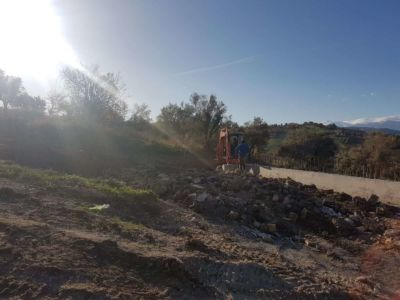 Filling Behind Retaining Wall in front of a new house being built in Le Marche, Italy
