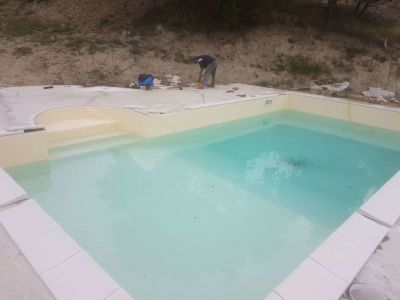 Filling the Pool as Part of Liner Installation at the site of new construction in Marche