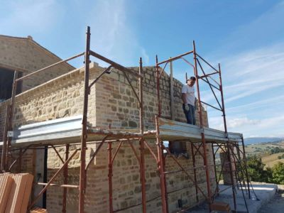 Finishing Roof Structure and Wall Above Kitchen at a new building site in Le Marche, Italy