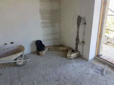 Fireplace Position in main room of a new house being built in Le Marche