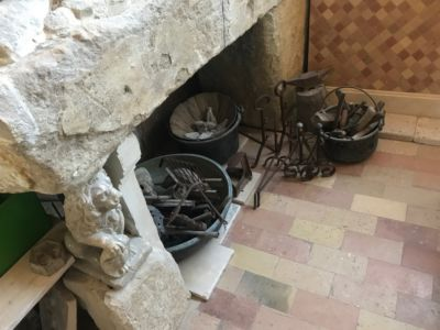 Fireplace with Tools for stone accent pieces for a new house in Le Marche
