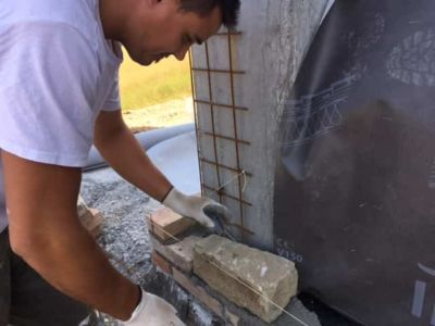 First Stone in Place on a new stone house in Le Marche