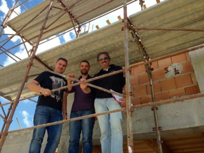 Francisc, Jimmy, and Kevin at a new building site in Le Marche
