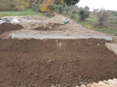 Front Slope Topsoil in front of a new house being built in Le Marche, Italy