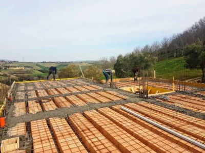 Rebar Grids on Top of Poroton Blocks building new house in Le Marche