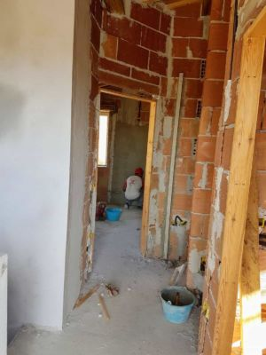Guest Room Toward Hall inside a new house being built in Le Marche