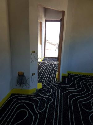 Heat for the Hallway using underfloor pipes at a new house in Le Marche