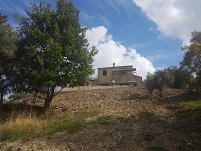 House From the Pool Level at the site of new construction in Marche