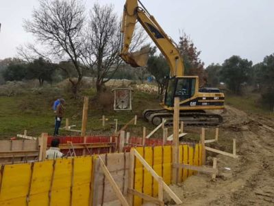 Starting to pour concrete for pool walls at building site in Le Marche
