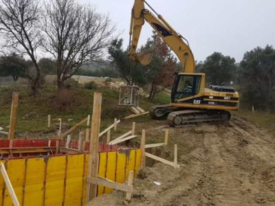 Pouring more concrete for pool walls at building site in Le Marche