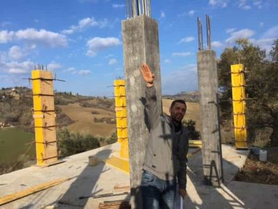 Jimmy and Columns at new house construction site in Le Marche