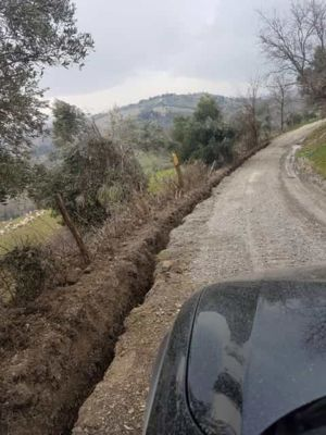 Access Road with Water Line Trench at new house construction site in Le Marche