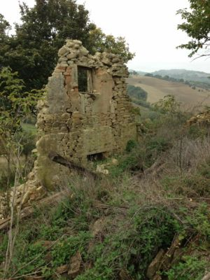 Ruin from front on site of new construction in Le Marche