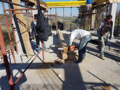 Cutting a Beam to Length at a new house construction site in Le Marche